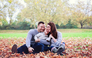 lifestyle family photography London: sitting in the red leaves