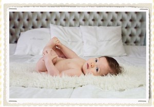 6 months old baby on a bed