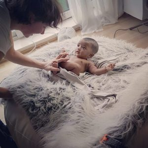 behind the scene photo during a baby photography session