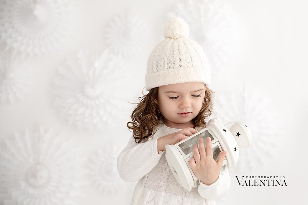 baby girl holding a lantern during Christmas mini session