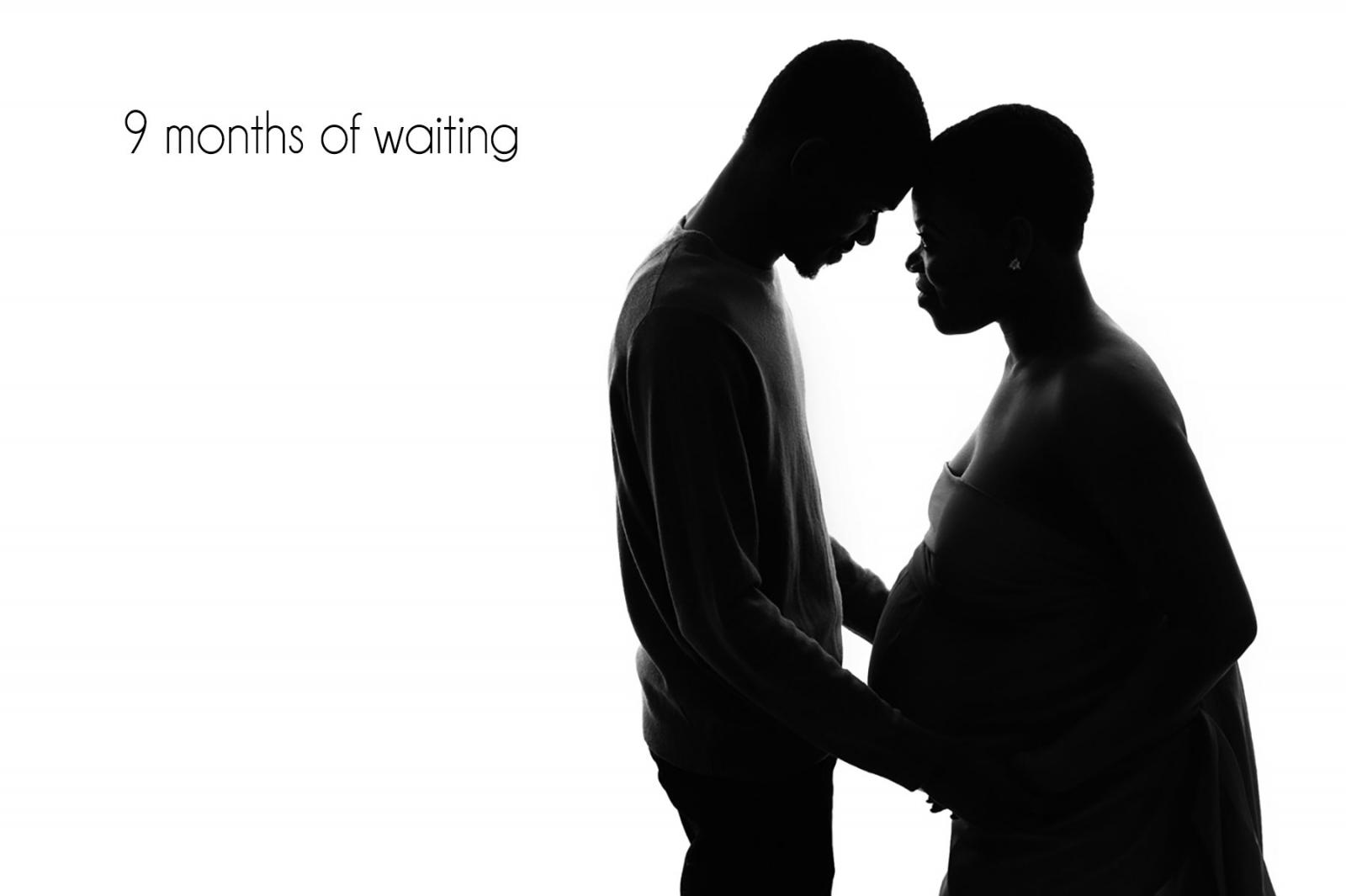 maternity photographer London: silouhette of mum to be and dad