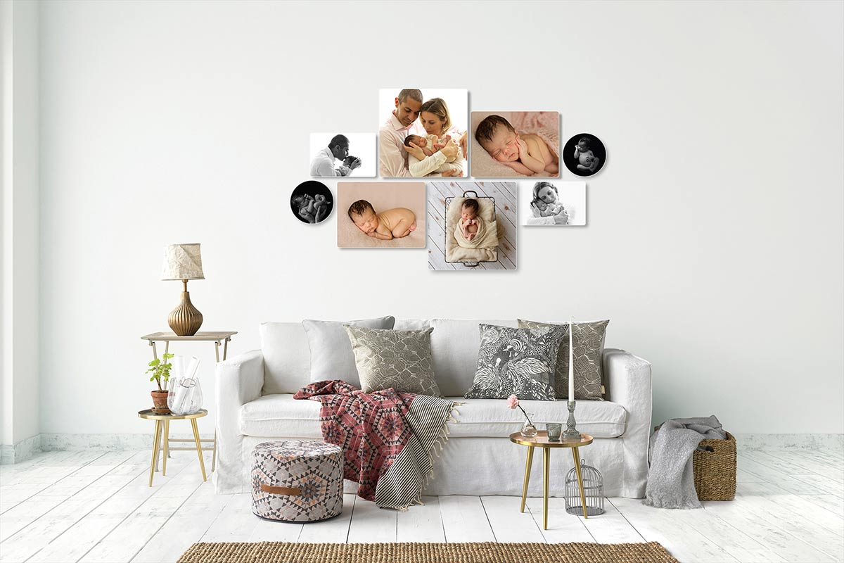 living room wall decorated with newborn photos