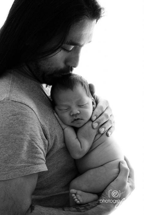 newborn photography: dad kissing baby on the head