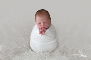 baby wrapped in a soft white wool wrap