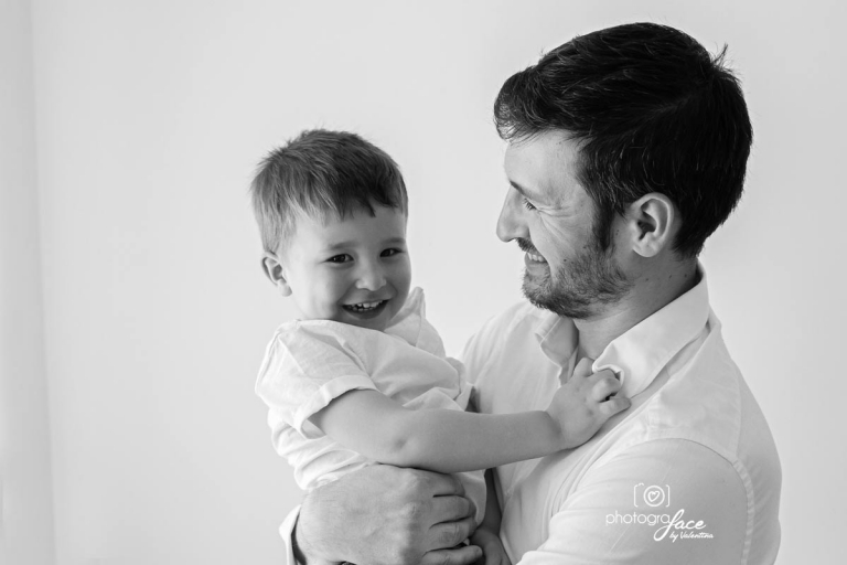 B&W image of son and dad laughing together - baby photography richmond