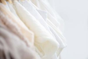 selection of newborn outfits available in the london studio