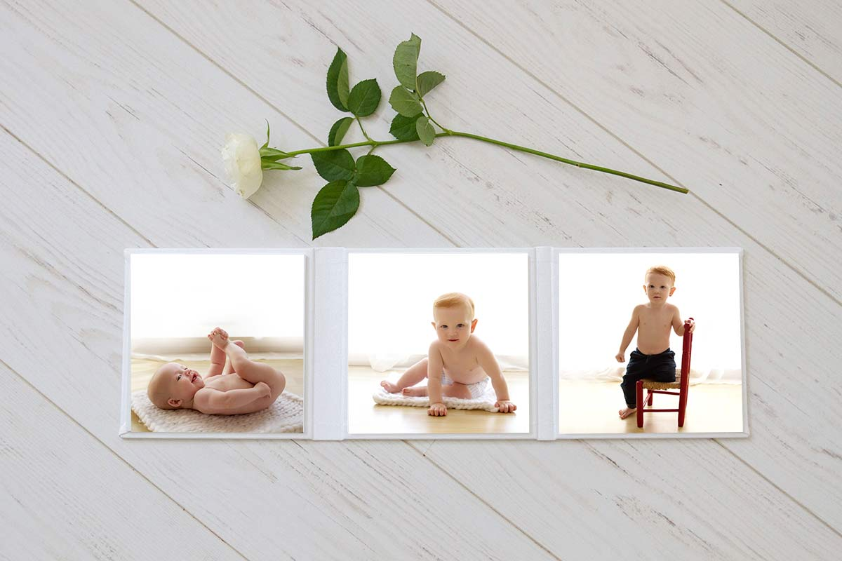 white leatherette folio with images from the baby plan photography