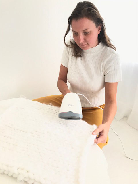 steaming a piece of delicate fabric used in newborn photography in my London studio