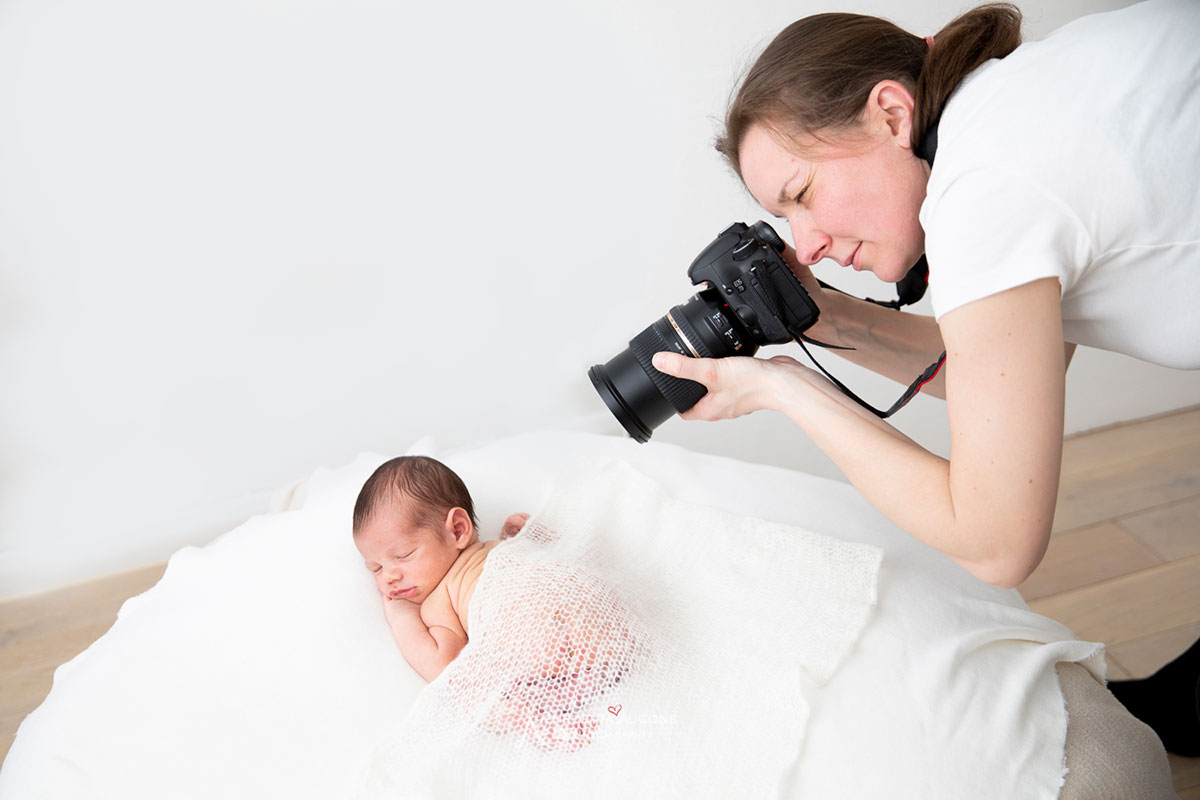 behnd the scene: london newborn photogrpaher valentina taking photo of a baby newborn